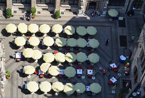 Bavaria Munich. View from the New City Hall Tower at noon to the courtyard Restaurant.