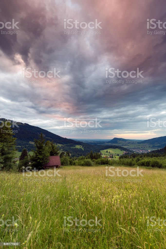 Bavarian Alps with mountain view and meadows in the Allgau stock photo