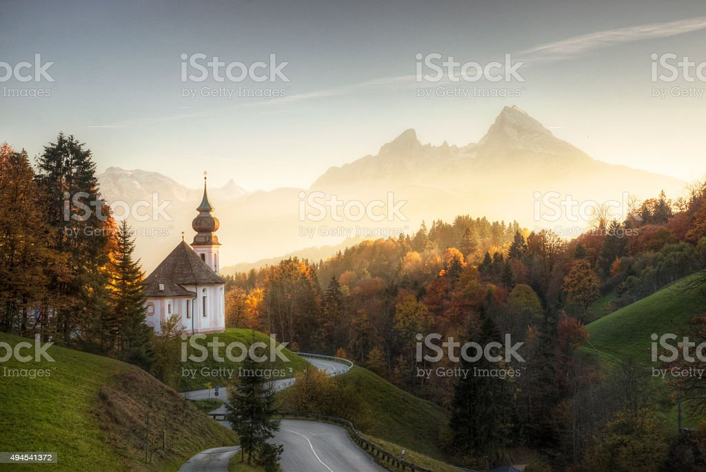 Bavarian Alps with Sunset Shining on Remote Church stock photo