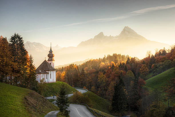 Bavarian Alps with Sunset Shining on Remote Church The church of Maria Gern nestled into a hillside in the Bavarian Alps and located just outside of Berchtesgaden. davelongmedia stock pictures, royalty-free photos & images