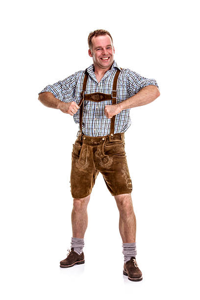 Bavarian / Austrian Man Posing for Fun Bavarian/Austrian man dressed in traditional lederhosen, isolated on white background.     davelongmedia stock pictures, royalty-free photos & images