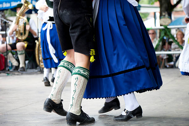 Bavarian couple in traditional outfits at Oktoberfest dance stock photo