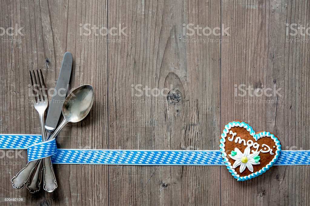 Bavarian cutlery on wooden table with copy space stock photo