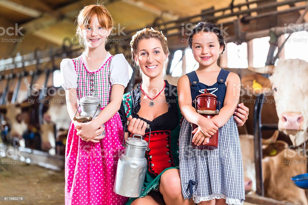 Bavarian family with milk can on cow farm stock photo