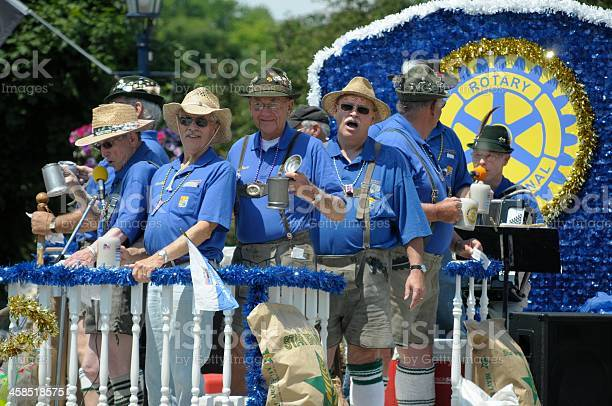 Frankenmuth, Michigan, USA - June 14, 2009: Members of the local Rotary Club dressed up in traditional Bavarian costumes having a good time during a festival in Frankenmuth, Michigan.