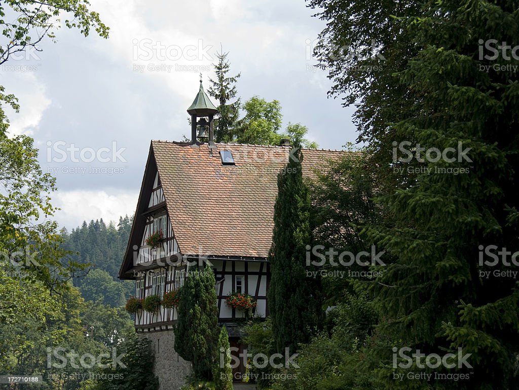Bavarian half timbered house with bell tower stock photo
