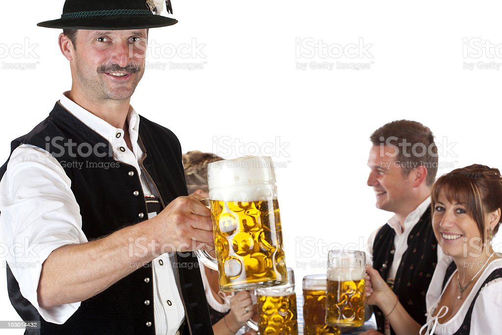 Bavarian man toasts to friends with Oktoberfest beer stein royalty-free stock photo