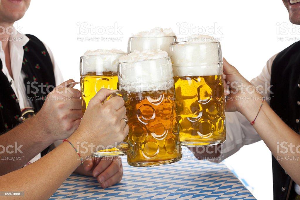 Bavarian men and women toast with Oktoberfest beer stein stock photo