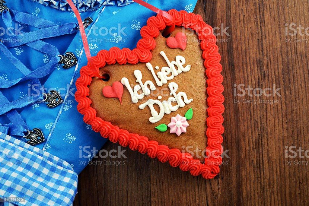 bavarian oktoberfest dirndl with gingerbread heart cake stock photo