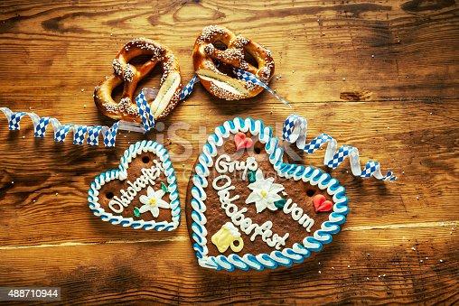 istock bavarian pretzel and Gingerbread hearts on wooden table, Oktoberfest 488710944