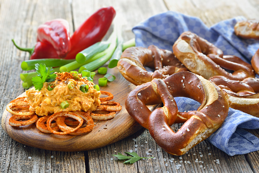 Fresh handmade original Bavarian pretzels from the domestic master baker served with a typical cheese preparation, the so-called 'obazda'