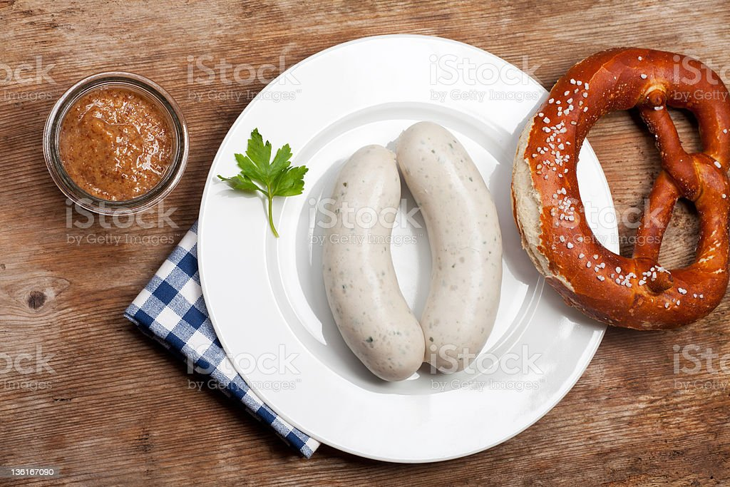 Bavarian white sausages served with sauce and a soft pretzel stock photo