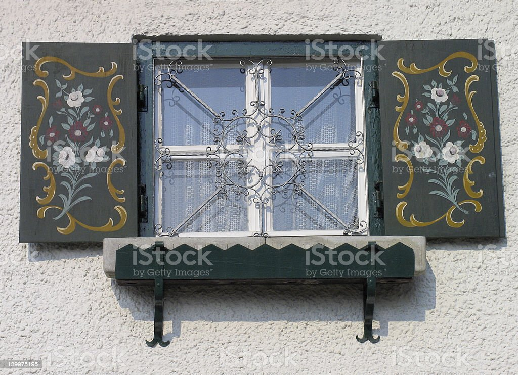 Bavarian window with shutters stock photo