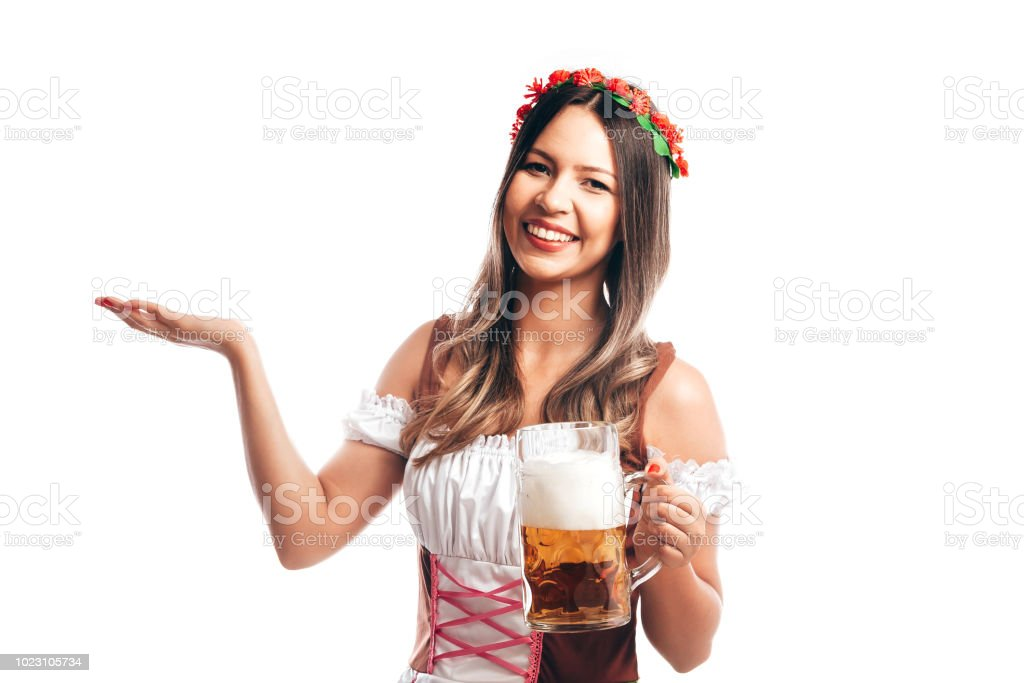 Bavarian woman celebrating the oktoberfest isolated on white background stock photo