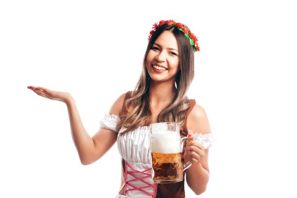 bayerische frau feiert das oktoberfest isoliert auf weißem hintergrund - bier kostüm stock-fotos und bilder