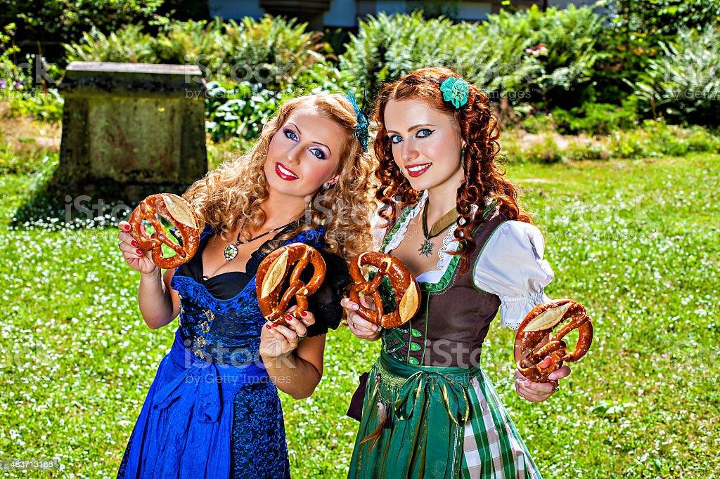 Bavarian Women With Pretzel Stock Photo - Download Image