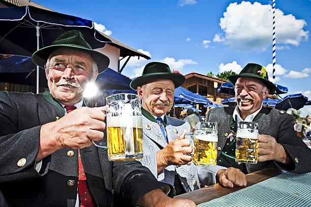 bavarians in the beergarden - german culture stock pictures, royalty-free photos & images