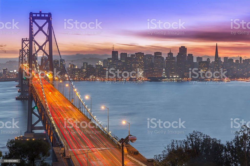 Bay Bridge and San Francisco skyline at sunset stock photo