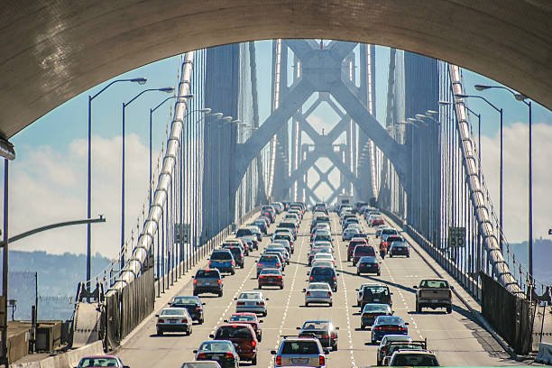 bay bridge of san francisco - traffic stock photos and pictures