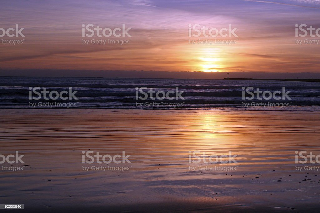 Bay colored by sunset stock photo