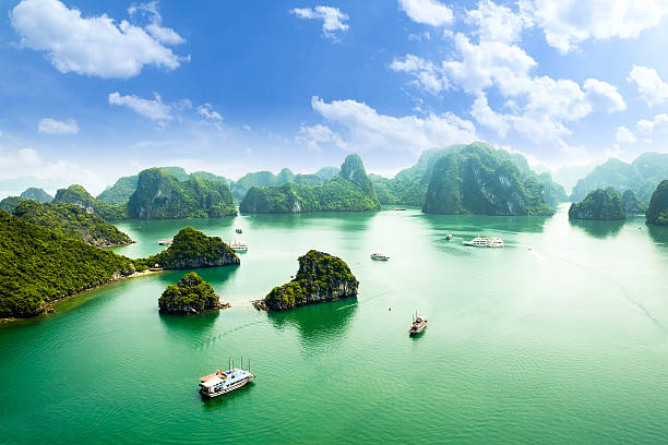 HALONG bay in vietnam HALONG bay in vietnam. UNESCO World Heritage Site. This view from TiTop island and its most popular view for travel in Halong bay. hanoi stock pictures, royalty-free photos & images