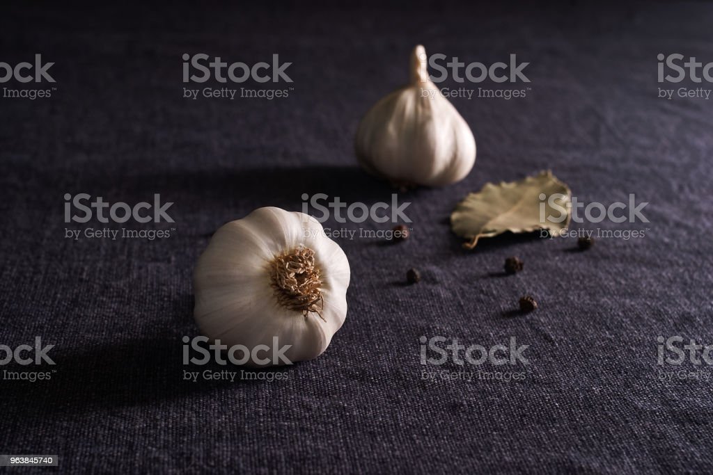 Bay leaf, onion and garlic on the dark textile table top. Dry Spices Mix - Royalty-free Bay Leaf Stock Photo