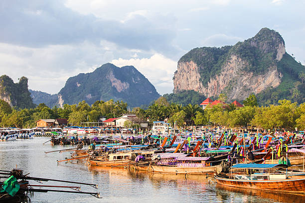 Bay of Ao Nang with lots of longtail boats stock photo