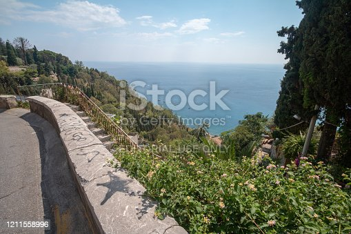 Ionian Sea in Taormina, Sicily, with graffiti on the wall