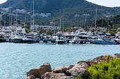 PORT ANDRATX, SPAIN - JUNE 01, 2016:\nView of the Bay of Port Andratx Mallorca Baleares Spain. In the background motor boats and sailboats.