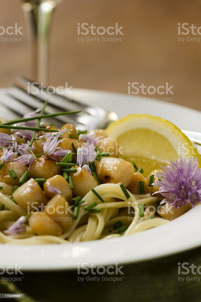 Bay Scallops over Linguine with Chive Lemon Butter Copy Space stock photo