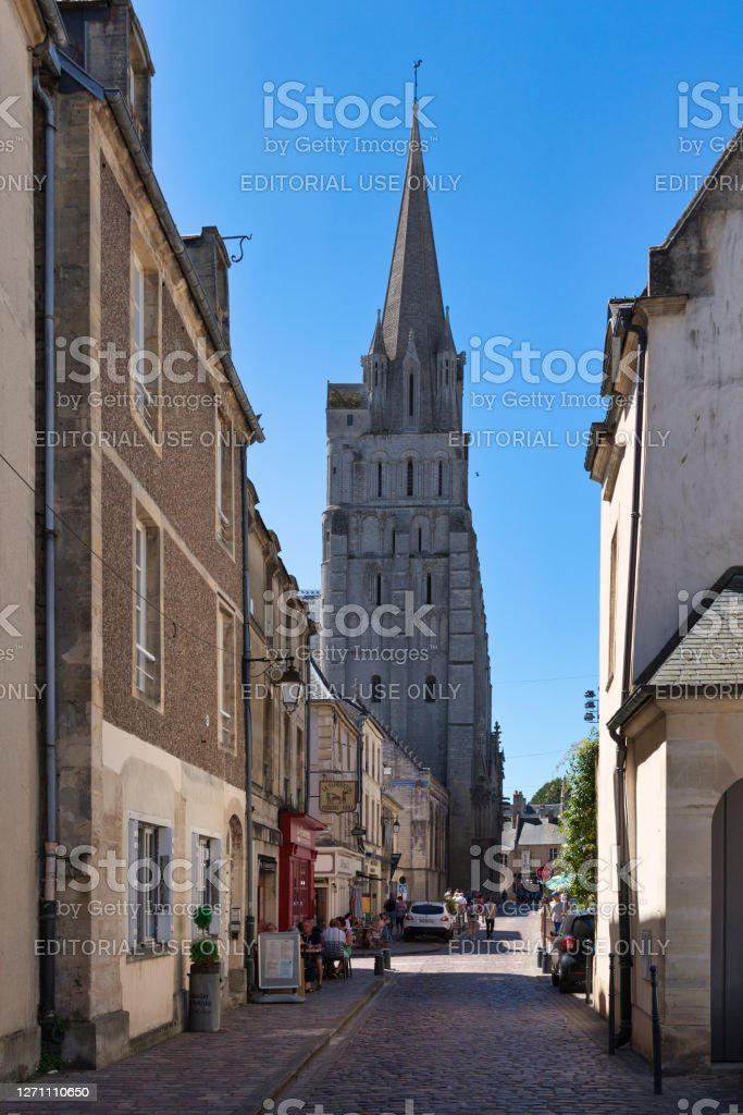 Bayeux Cathedral Bayeux, France - August 06 2020: The Notre-Dame de Bayeux Cathedral is a Gothic-style cathedral located in the old town, which is the seat of the diocese of Bayeux and Lisieux corresponding to this department. Architecture Stock Photo