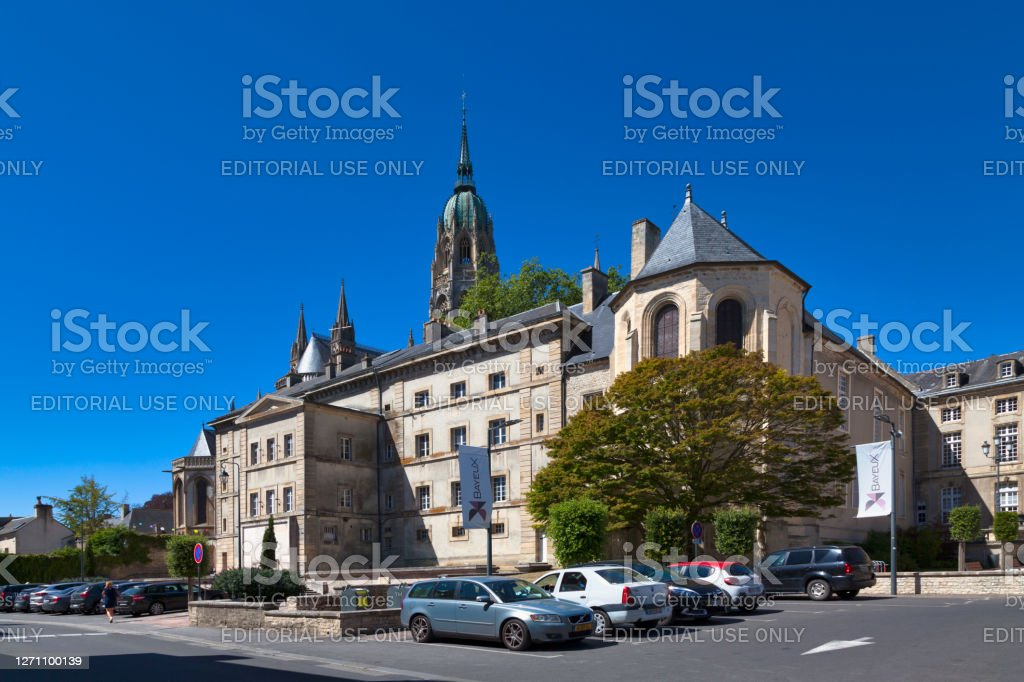 Bayeux Episcopal Palace Bayeux, France - August 06 2020: Bayeux Episcopal Palace (or Bishop's Palace of Bayeux) with the spire of the Cathedral behind it. Architecture Stock Photo