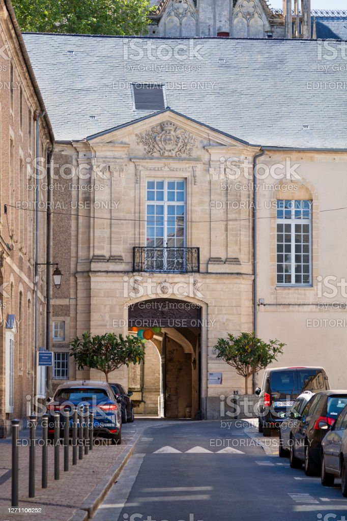 Bayeux Episcopal Palace Bayeux, France - August 06 2020: Entrance passing through the Bayeux Episcopal Palace (or Bishop's Palace of Bayeux) to the Place de la Liberté. Architecture Stock Photo