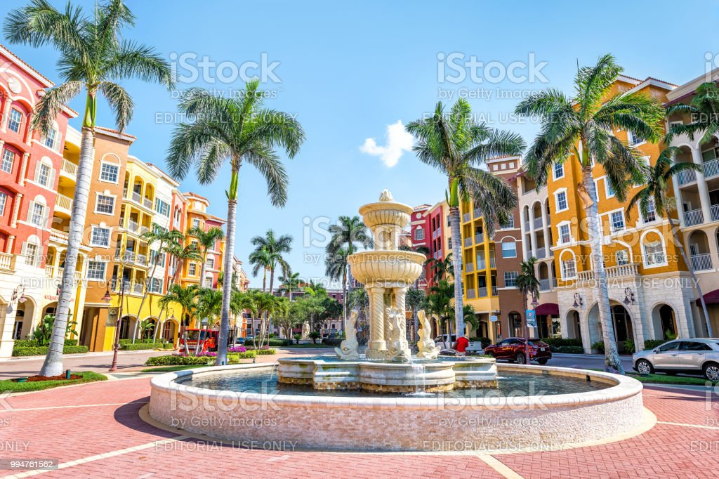 Bayfront condos, condominiums colorful, multicolored, multi-colored buildings with fountain, water, palm trees, blue sky in residential community stock photo