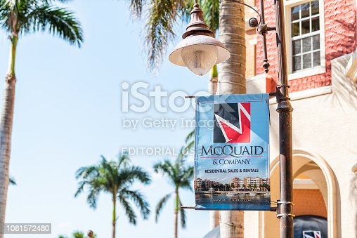 istock Bayfront condos, condominiums colorful sign for McQuaid Company residential sales and rentals buildings with palm trees, blue sky in community 1081572480