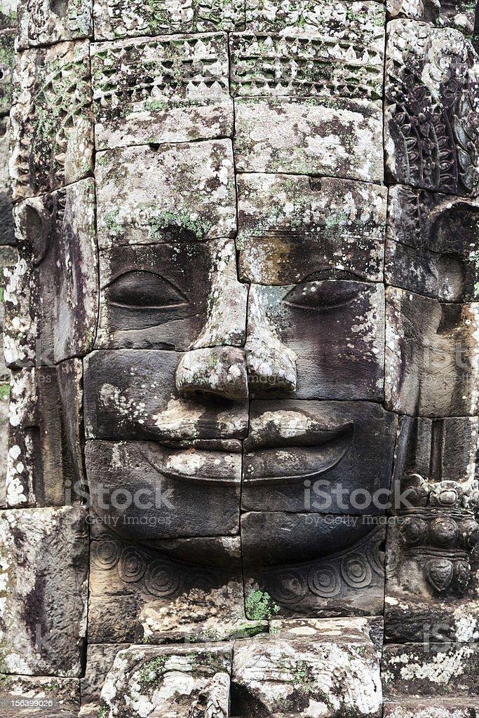 Bayon Buddha face in Angkor, Cambodia royalty-free stock photo