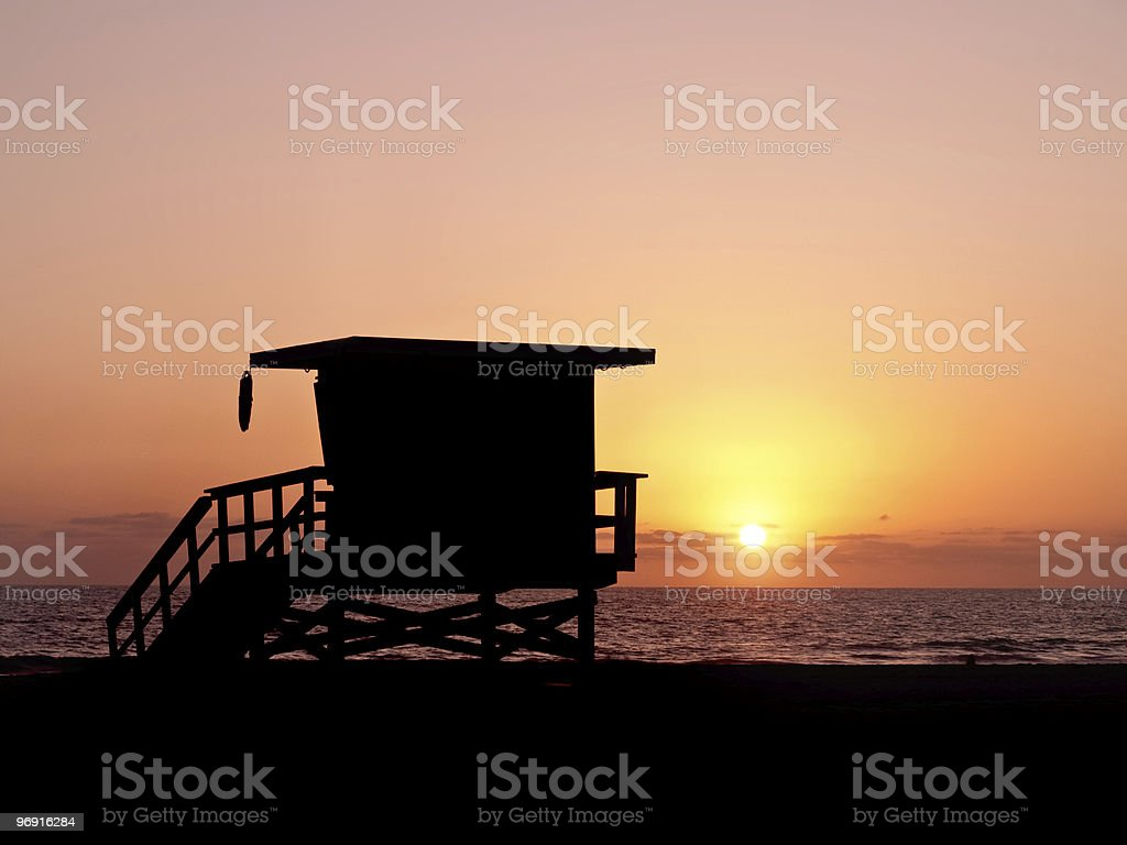 baywatch lifeguard tower sunset royalty-free stock photo