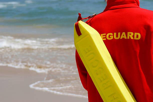baywatch lifeguard with float at a beach - livbåt bildbanksfoton och bilder