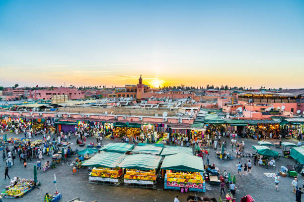 Bazaar in medina of Marrakech. Jemaa el-Fna in sunset. stock photo
