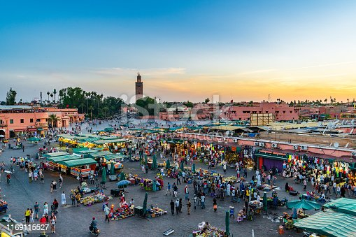 Shopping arcades on Jemaa el-Fna Marrakech market. Merchants sell various goods to tourists and locals.