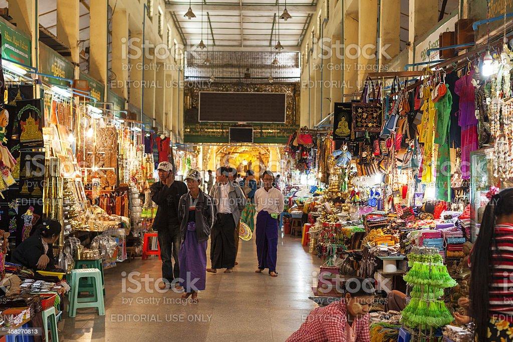 Bazaar street leading up to Golden Buddha in Mandalay stock photo