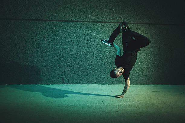 bboy doing handstand on street - street dance bildbanksfoton och bilder