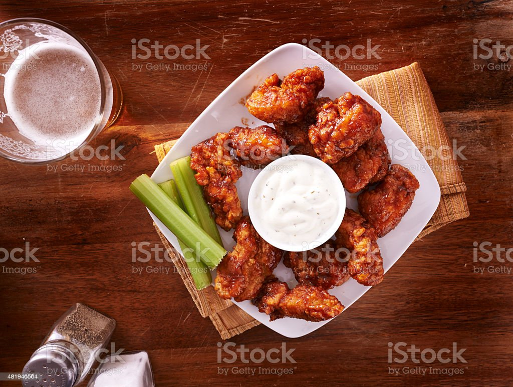 bbq buffalo chicken wings with beer stock photo