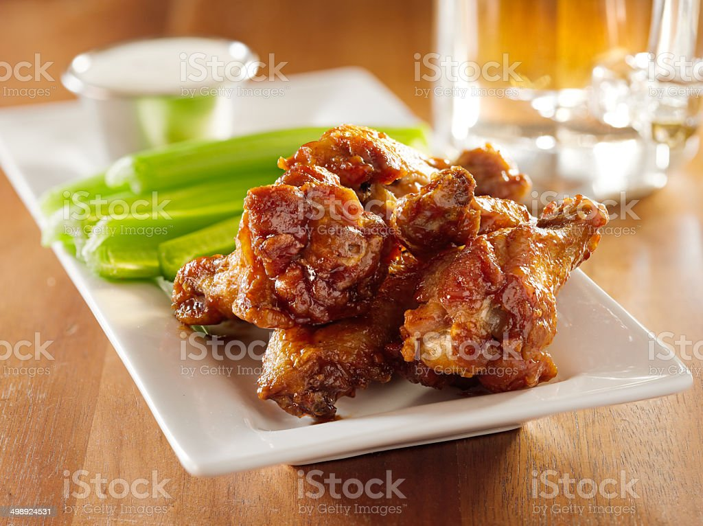 bbq buffalo wings with celery and ranch. stock photo