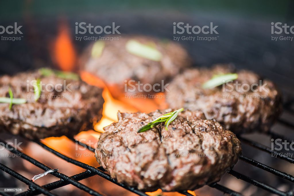 bbq burgers, smoke and fire stock photo
