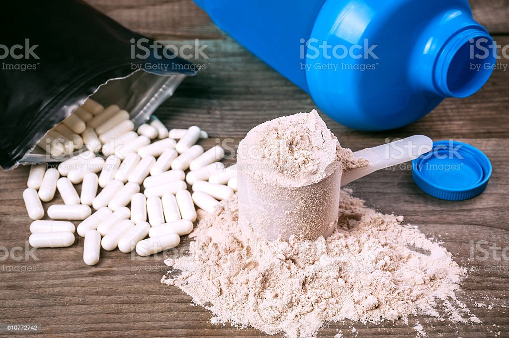 bcaa pills and protein stock photo