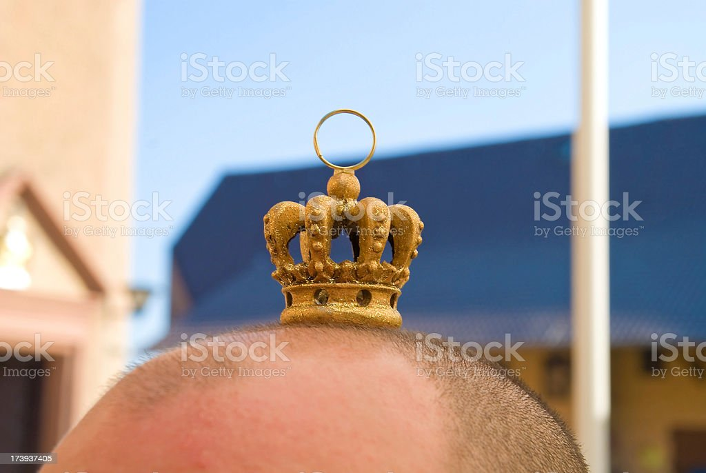 be a king with small crown on skinhead stock photo