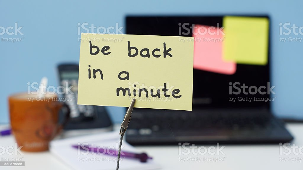 Be back in a minute stock photo