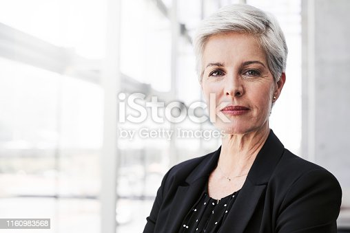 Portrait of a confident mature businesswoman standing in a convention centre