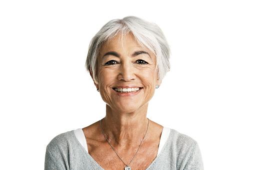 Studio portrait of a senior woman posing against a white background